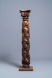 A carved walnut Ionic column with grapevines, 17th C.