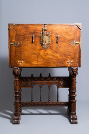 A Spanish bronze-mounted oak 'bargueño' or cabinet on stand, 16th C.