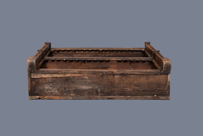 A carved oak shelf with pinnacles and stylised flowers and carved panels, 15th C. and later