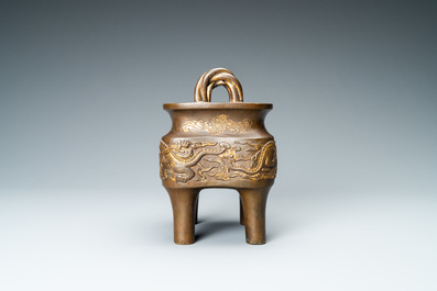 A Chinese partly gilded bronze censer with jade-topped wooden cover, Xuande mark, Kangxi