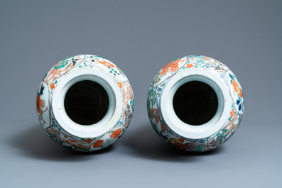 A pair of Chinese famille verte 'mythical animals' vases, Kangxi