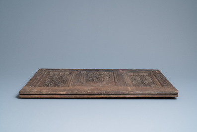 A carved oak front panel of a coffer with tracery panels, 15th C.