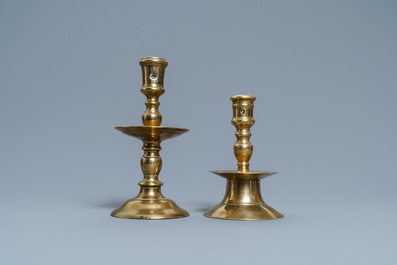 A Flemish bronze capstan candlestick and a disc candlestick, 16/17th C.