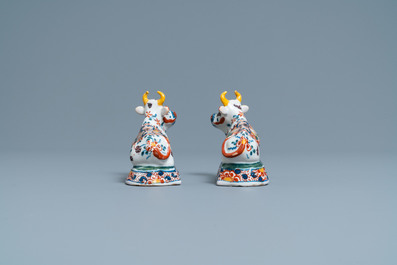 A pair of polychrome Dutch Delft models of cows, 18th C.