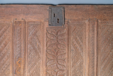 A carved oak front panel of a coffer with tracery panels and geometrical motives, Brittany, France, 17th C.