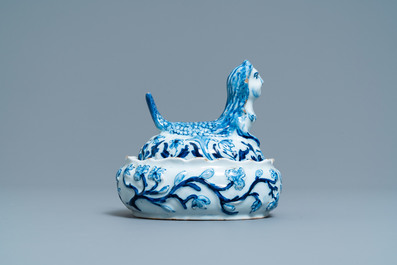 A Dutch Delft blue and white butter tub in the shape of a mermaid, 18th C.