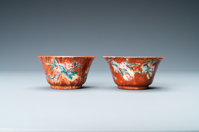 A pair of Chinese famille rose 'faux-bois' cups and saucers, Yongzheng/Qianlong