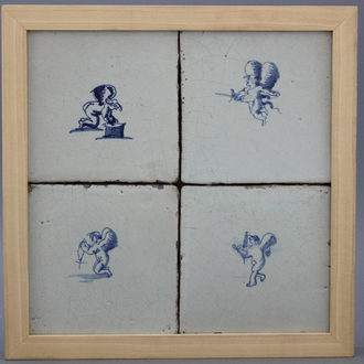 A framed set of 4 Dutch Delft tiles with amors 17th C.