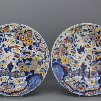 A pair of large polychrome Dutch Delft dishes with birds and flowers, 17th C.