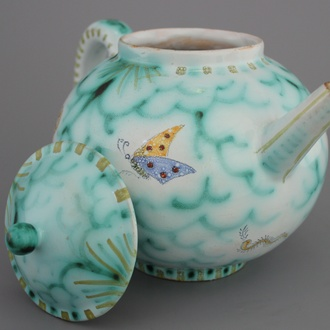 A rare Brussels faience teapot and cover with butterflies, 18th C.