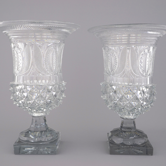 A pair of large cut glass urns on stand, probably Voneche, early 19th C.