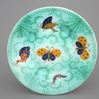 A Brussels faience round butterfly decor plate, 18th C.