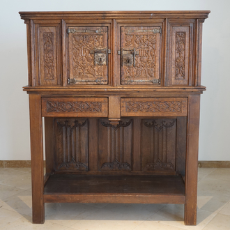 A Flemish oak credence with IHS panels, 16th C. with later adaptations