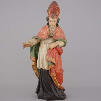 A polychrome carved wood figure of a bishop, 18th C.