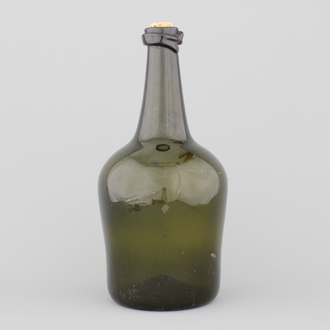 A large green glass free-blown wine bottle, 18th C.