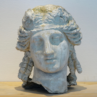 A plaster cast of a female's head, after the Antique, 19/20th C., Bruges