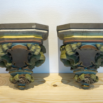A pair of polychrome plaster consoles, 19/20th C., Bruges