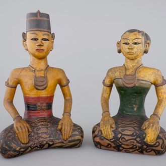 Two tall Indonesian cold-painted pottery figures of servants, 19th C.