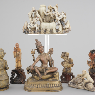Two Chinese or Tibetan bronze figures, one of Tara seated on a tiger and a set of soapstone carvings, 18/19th C.