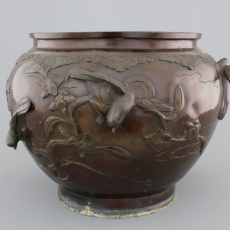 A Japanese bronze relief-decorated jardiniere, 19th C.