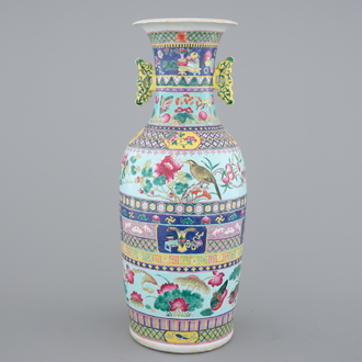 A tall Chinese famille rose vase with birds among flowers between colored bands of symbolim, 19th C.