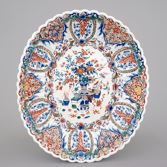 A fluted oval Dutch Delft dish in cashmere palette, ca. 1700