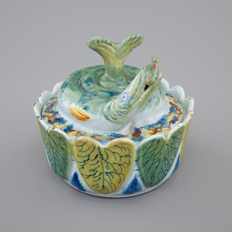 A Dutch Delft polychrome butter tub in the form of a pike, 18th C.