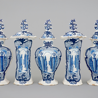 A 5-piece blue and white Dutch Delft garniture with architectural design, 18th C.
