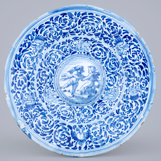A blue and white cardinals dish with putti, Delft or Haarlem, 17th C.