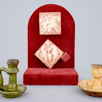 Two medieval tiles and two late medieval candlesticks, 16/17th C.