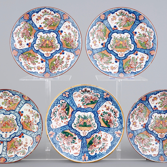 A set of five polychrome Dutch Delft plates with flower baskets, 18th C.