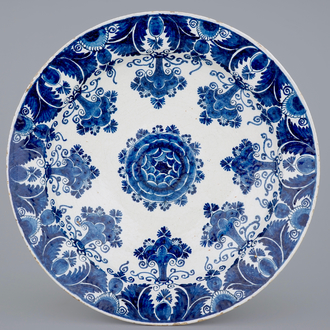 An exceptionally large Dutch Delft blue and white floral dish, 18th C.