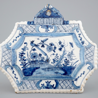 A blue and white Dutch Delft floral chinoiserie plaque, 18th C.