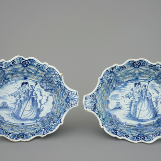 A pair of Dutch Delft blue and white openworked baskets, 18th C.