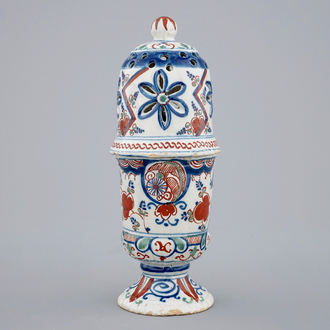 A polychrome Dutch Delft caster with lightning decoration, late 17th C.