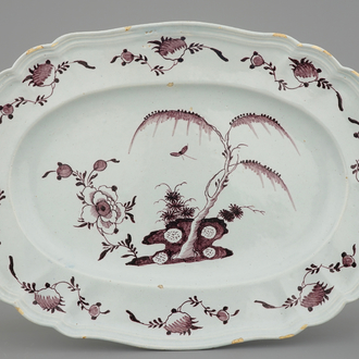 A large oval manganese Dutch Delft floral dish, 18th C.