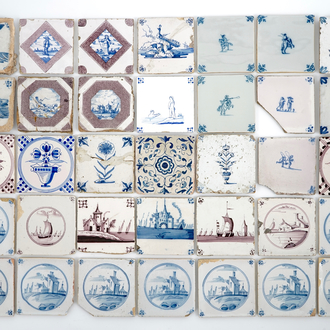 A large collection of antique Dutch Delft and other tiles, 18/20th C.