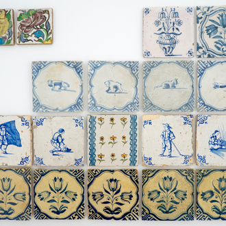 A set of 14 antique blue, white and polychrome Delft tiles, 17/19th C.