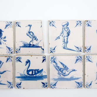 A set of 8 unusual blue and white Dutch Delft tiles, 18th C.