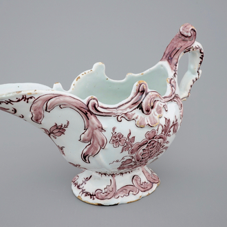 A manganese Dutch Delftware sauceboat, 18th C.