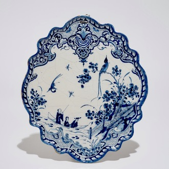 A Dutch Delft blue and white chinoiserie plaque with figures in a boat, 1st half 18th C.