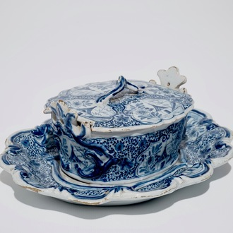 A Dutch Delft blue and white butter tub on stand, 18th C.