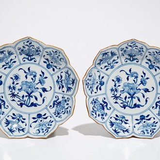 A pair of Dutch Delft blue and white lotus-shaped plates, 18th C.