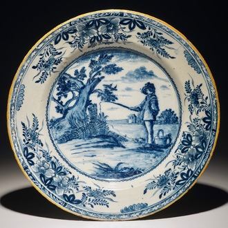 """A Dutch Delft blue and white dish depicting """"The young fisherman"""" after Bloemaert, 18th C."""