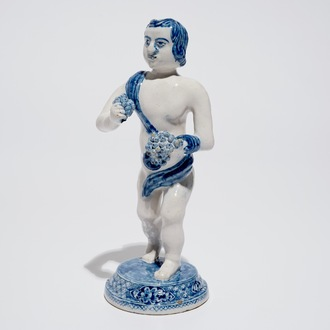 A Dutch Delft blue and white model of Bacchus, early 18th C.