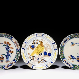 Three polychrome Dutch Delft plates with quails and a parrot, 18th C.