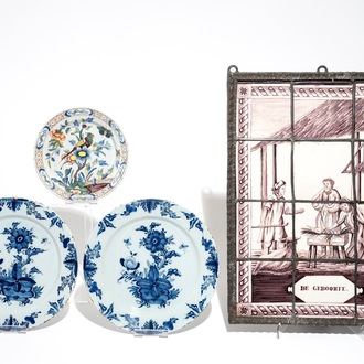 A manganese Dutch Delft tile panel and three Delft dishes, 18/19th C.