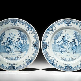 A pair of Dutch Delft blue and white plates with galant scenes, 18th C.