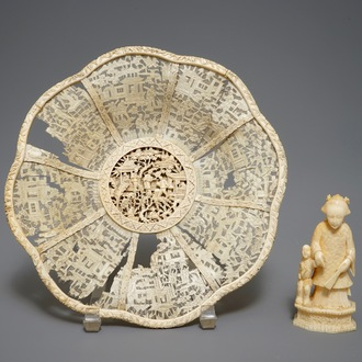 A Chinese pierced ivory basket and a small group of a lady with child, 19th C.