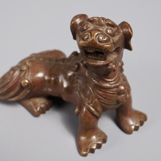 A Chinese bronze scroll or paper weight shaped as a Buddhist lion or Shishi, 18/19th C.